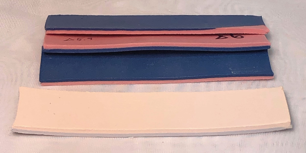 Bi-clay strips of blue:pink porcelain have firing straight
