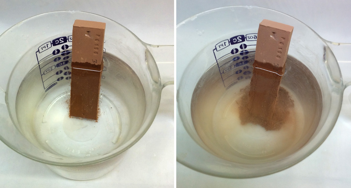 A clay bar is immersed in a cup of water and slaking.