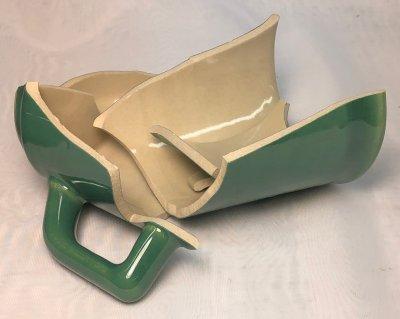 A broken slip cast cone 6 mug