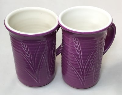 Two purple-outside, white inside thrown Grolleg cone 6 porcelain mugs