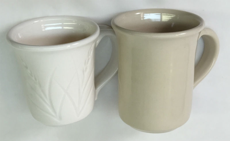 Side by side mugs, a porcelain made using only kaolin and one made with ball clay