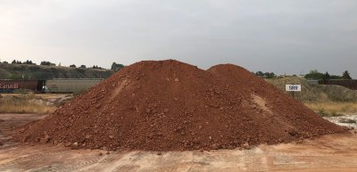 A pile of red clay in the lump form