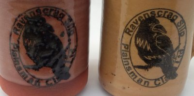 Two ceramic mugs with a rubber-stamped logo using a stain/glycerine ink