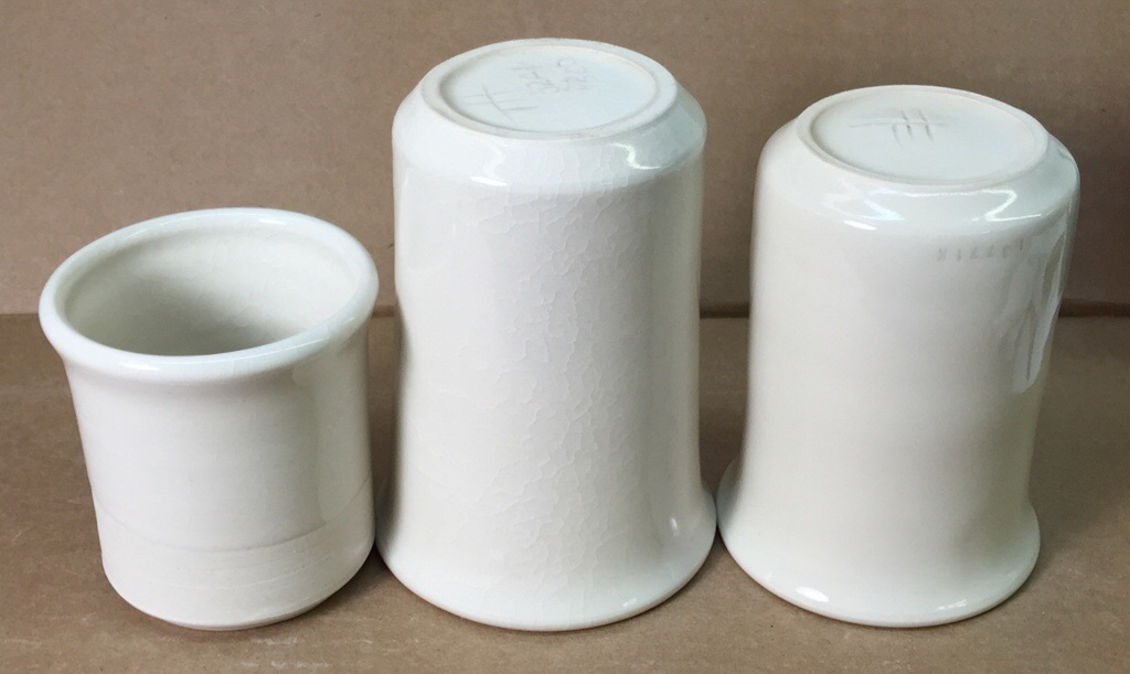 Thee porcelain mugs, the glaze on two are crazed