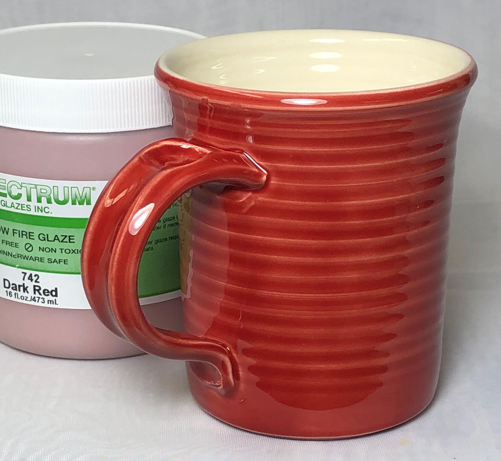 A red glossy earthenware mug