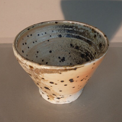 Heavily speckled eduction fired porcelain Shino bowl by Glenn Lewis