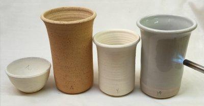 Stoneware mug endures thermal shock better than kaolin or ball clay