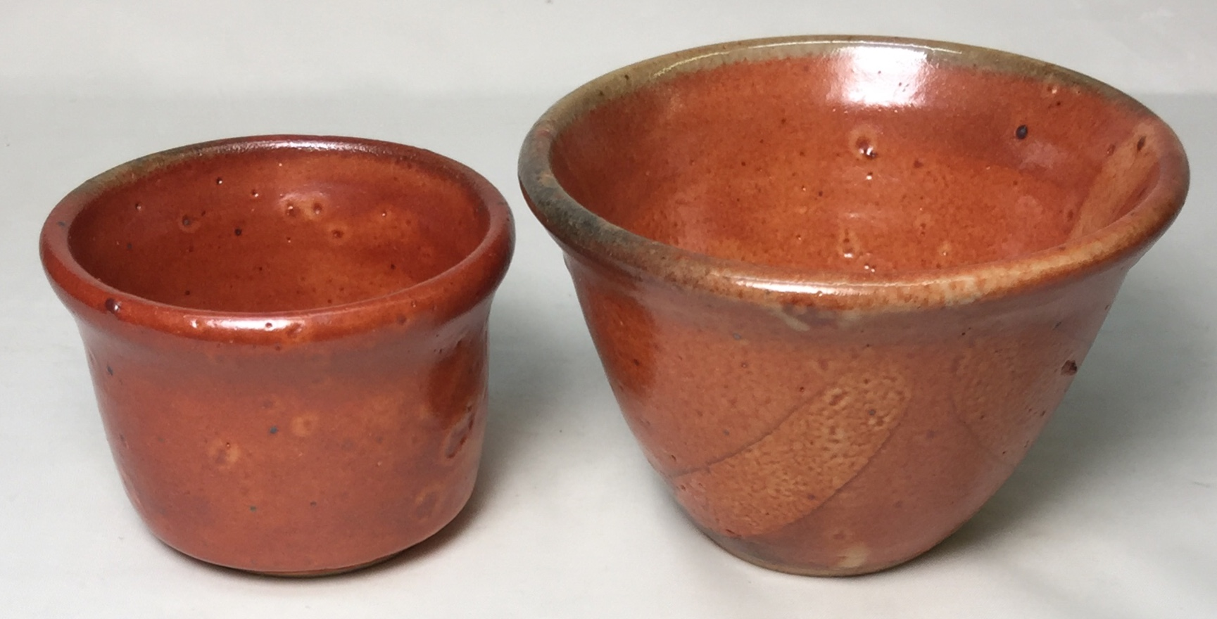 Two small brown, matte bowls