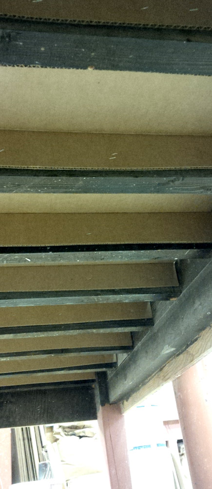 Underside of plaster table frame with cardboard retainers in place