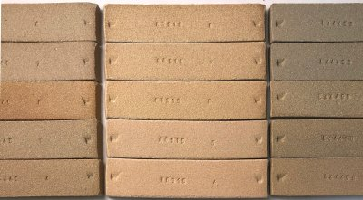 Three sets of fired clay test bars comparing degree of vitrification