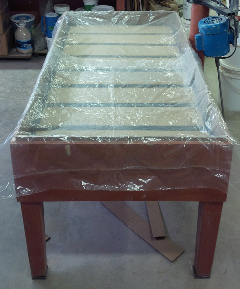 Plaster table frame with plastic in place, ready to pour