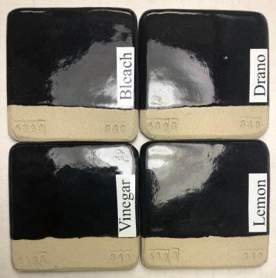 Four black-glazed test tiles