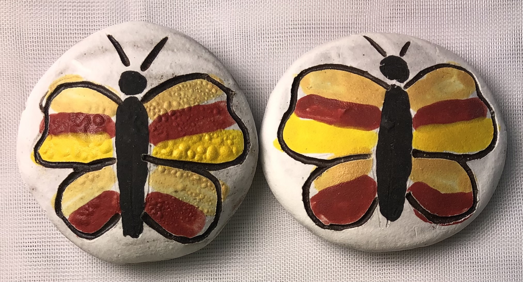 Clay rocks with butterfly pattern