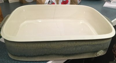 A casserole dish with a dunting crack going down from the rim