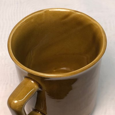 The inside view of a fired mug showing uneven wall thickness