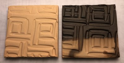Clay tiles, one unglazed, one carbon glazed