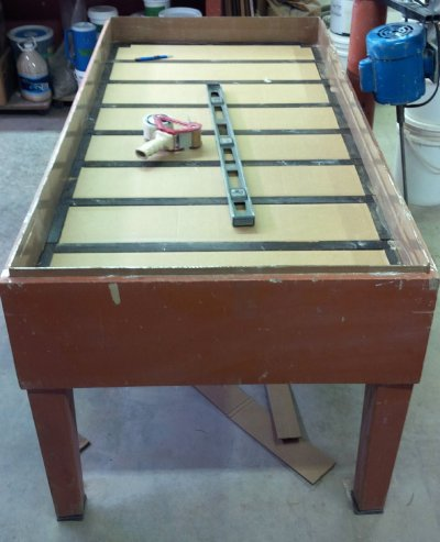 Plaster table frame with cardboard liners around the outer edge