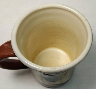 The white inside of a mug is coffee-staining