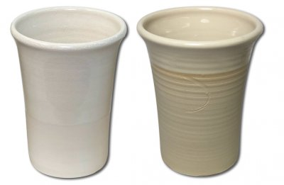 Two clear glaze cups show the color and glaze fit differences between feldspar and kaolin