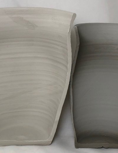 Two dissected vases, side-by-side, showing the comparison in wall thickness