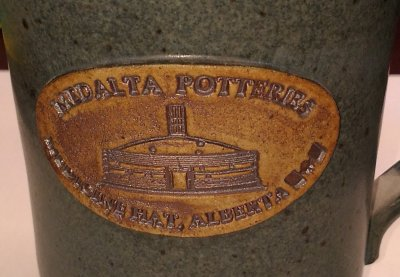 Medalta Potteries letterpress stamp in a cone 6 stoneware mug