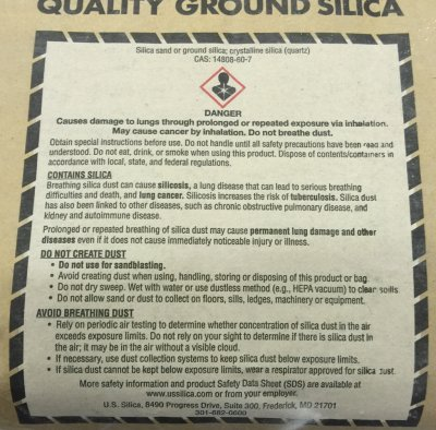 Health warning phrases on a bag of ground silica