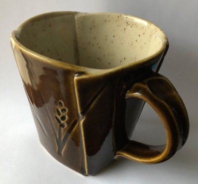 A mug made of manganese speckled clay