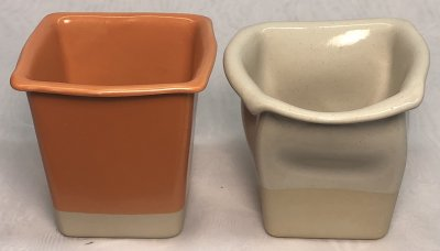 Two warped small square planter shapes