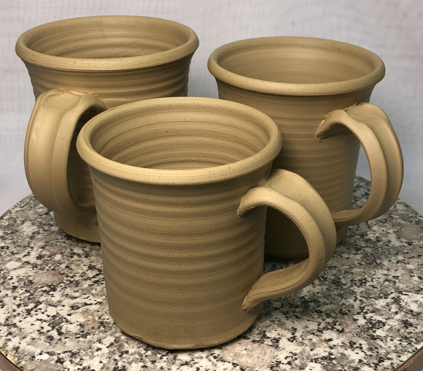 Two freshly thrown mugs made from pure Lincoln 60 fireclay