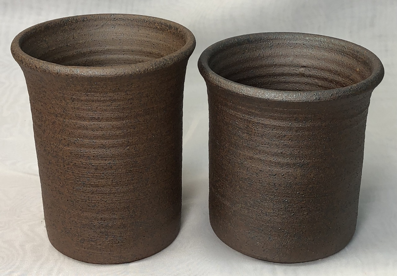 Two vessels made from a vitreous metallic reduction stoneware