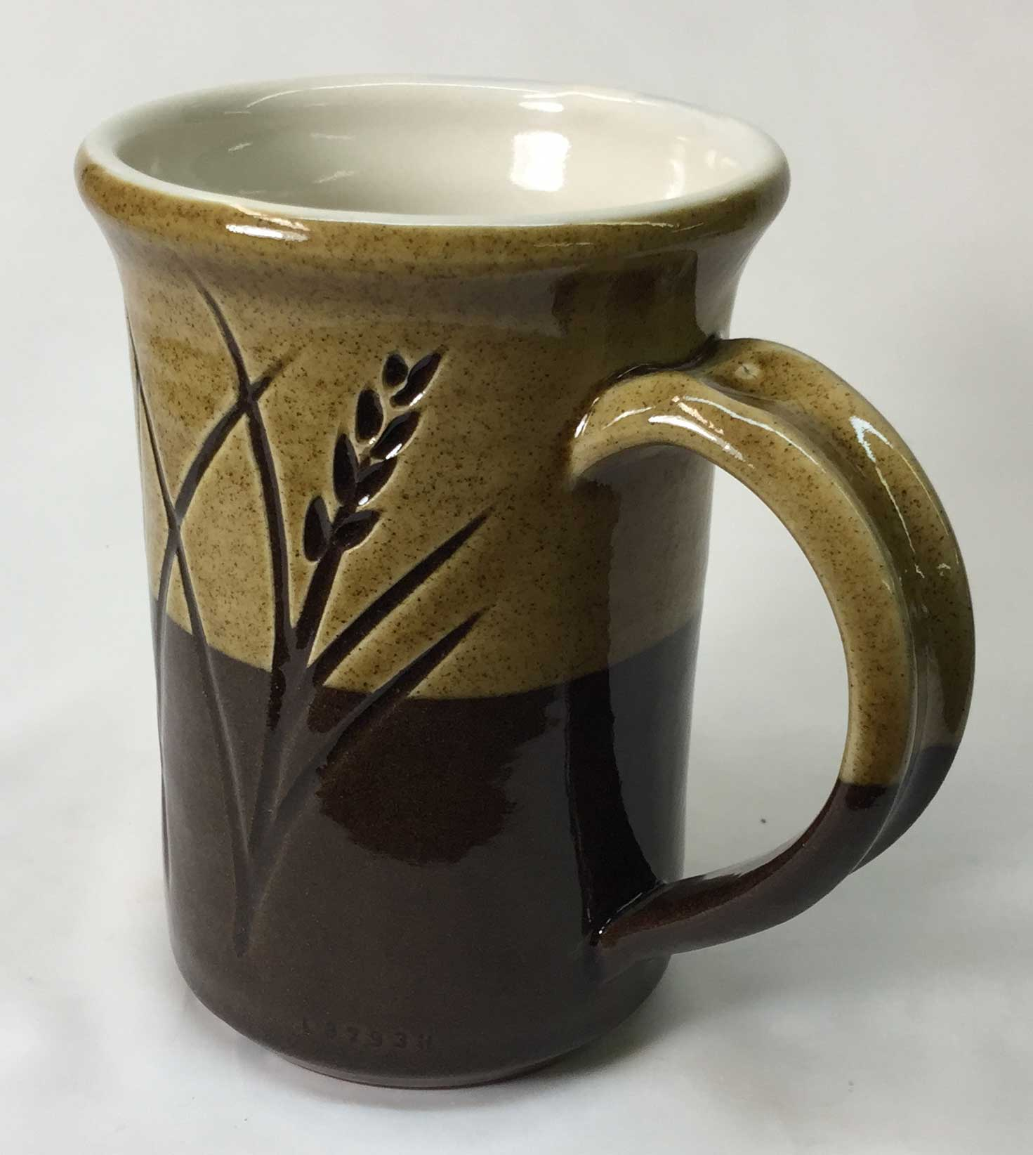 Rich, natural but vibrant colors. How was this cone 6 mug made?