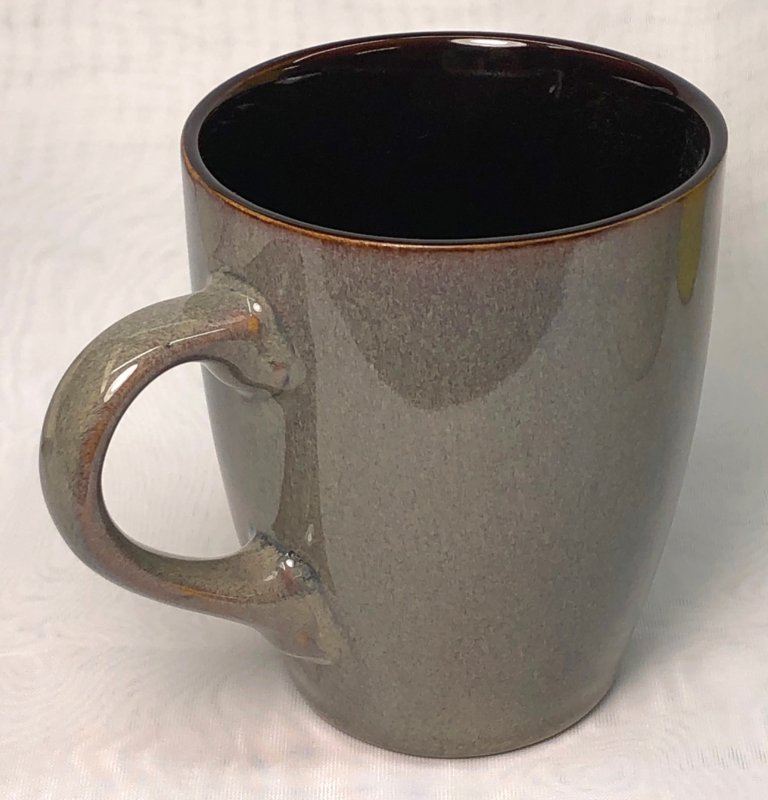 A commercial rutile-glazed mug