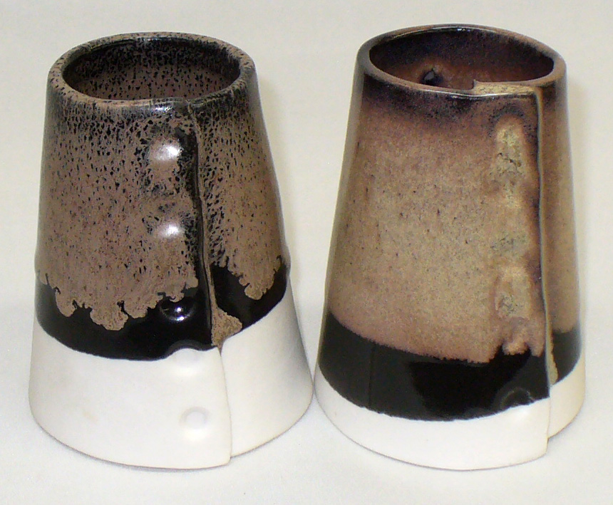 Cone 6 black with a second layer of oatmeal glaze