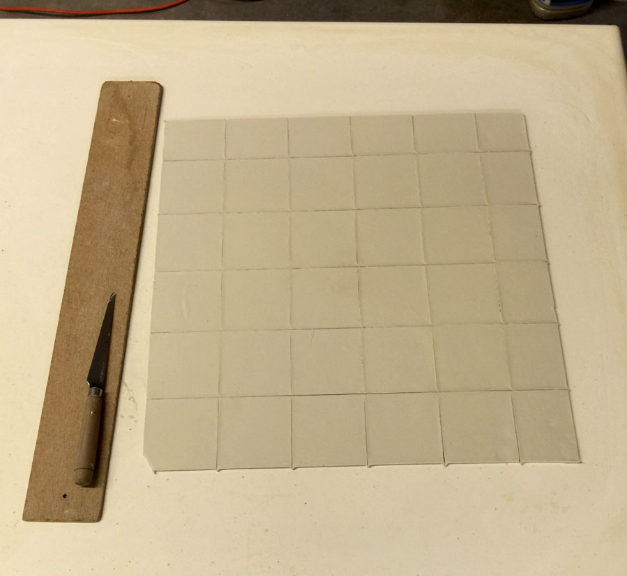 Flat thin vitreous tiles being made for GMFA melt fluidity testing