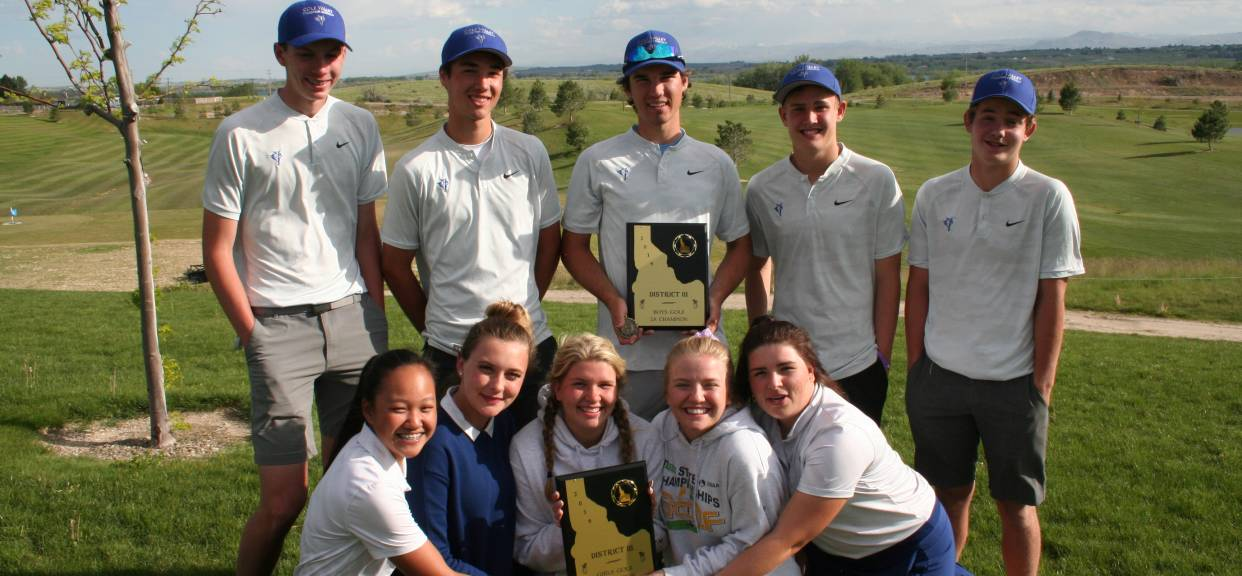 Boys and Girls win districts