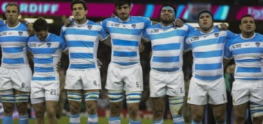 Momento del himno y cara de orgullo y pasión de Ramiro Herrera, con el número 3 en su pantalón, en uno de los partidos que disputó con el seleccionado argentino en el mundial.