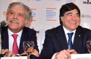 Sonrisas. El ministro De Vido junto con el candidato y secretario Zannini, durante la cumbre en Neuquén.