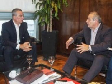 Cumbre. Cassinotti (izquierda) escuchó las quejas del ministro.