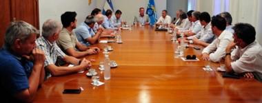 Cumbre. El mandatario dialogó con los referentes empresariales para garantizar un piso de obra pública.