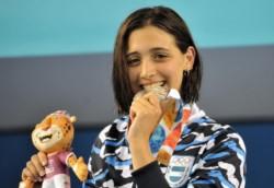 La sonrisa de Delfina Pignatiello al recibir la medalla de plata es la alegría de todos.