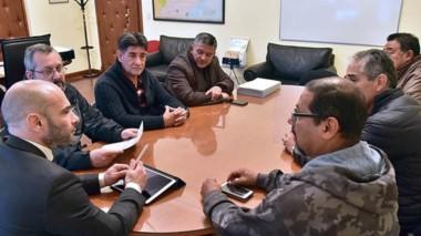 Aval. El ministro Massoni junto a los miembros de una organización vinculada a un tema muy sensible.