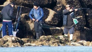 Imagen. Con un potente lente, el fotógrafo aficionado consiguió distinguir las acciones de los pescadores. (Foto: Nestor Sandoval)