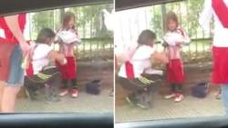 Filmaron a una mujer escondiendo bengalas en la ropa de una nena.