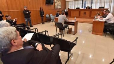 Sopresivo. Miquelarena escucha el relato de Musante ante el juez Piñeda, los fiscales y la defensa.