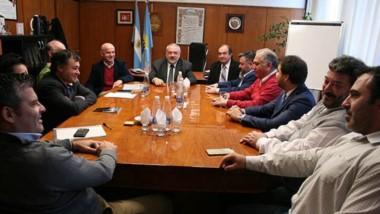 Cúpula económica. Ramírez flanqueado por Garzonio y Tarrío, durante la histórica asamblea de la entidad.