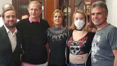Patricio Di Palma, su hija y los padres de Justina Lo Cane tras la sanción de la ley.