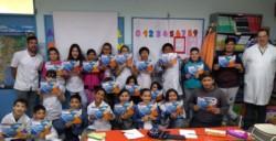 """Alumnos de la  Escuela N°185, en el programa social """"La Cooperativa en tu escuela"""
