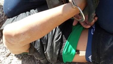 Uno de los detenidos durante los procedimientos policiales.