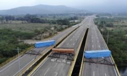 EEUU y otros países tratan de ayudar, pero militares de Venezuela obstruyen ayuda con camiones y contenedores bajo órdenes de Maduro.