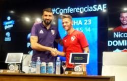 Lucas Pratto y Nicolás Domingo se despiden luego de dialogar con la prensa.